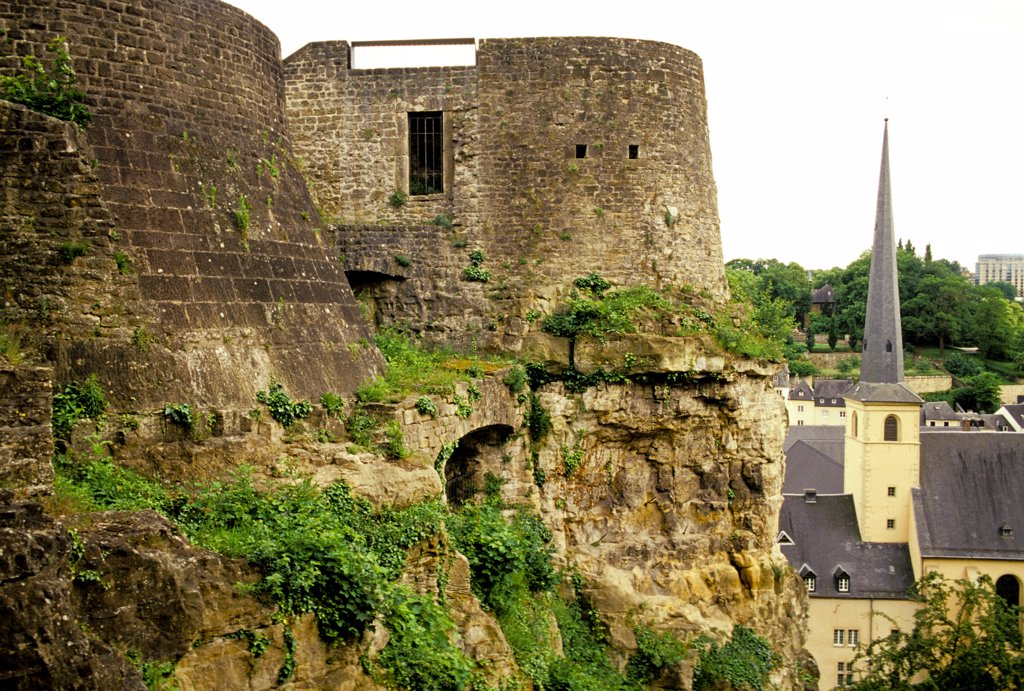 Stock Photo: 1899-60260 Luxembourg. Luxembourg City. Casemates (Left). Saint-Jean Baptiste (St. John Church) (Neumunster) Steeple Detail (Right).