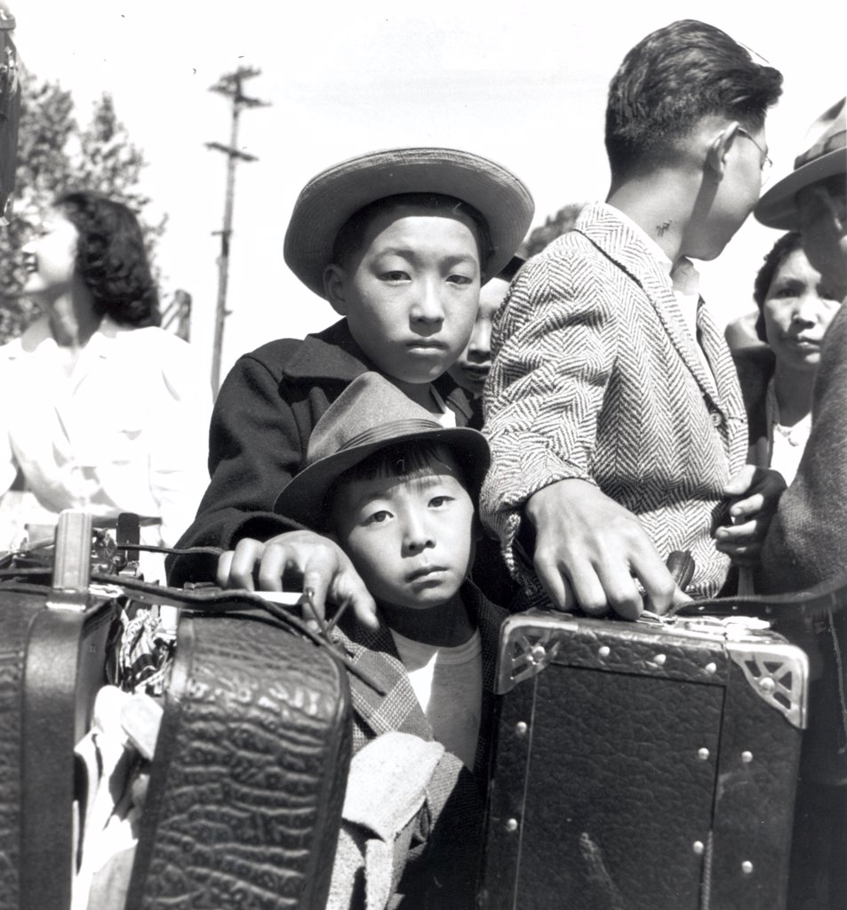Stock Photo: 1899-60878 Turlock, California. These Young Evacuees Of Japanese Ancestry Are Awaiting Their Turn For Baggage Inspection At This Assembly Center. 05/02/1942 Photographer: Dorothea Lange