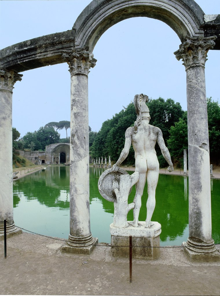 Stock Photo: 1899-64309 Hadrian's Villa, a complex of buildings, gardens and pools stretching for over a kilometre in length, The Canopus: this elongated pool seems to have represented the Canopus, a famous canal between Alexandia and Canopus in Egypt. One of the statues decorating the Canopus, Hadrian's Villa. Italy. Roman.