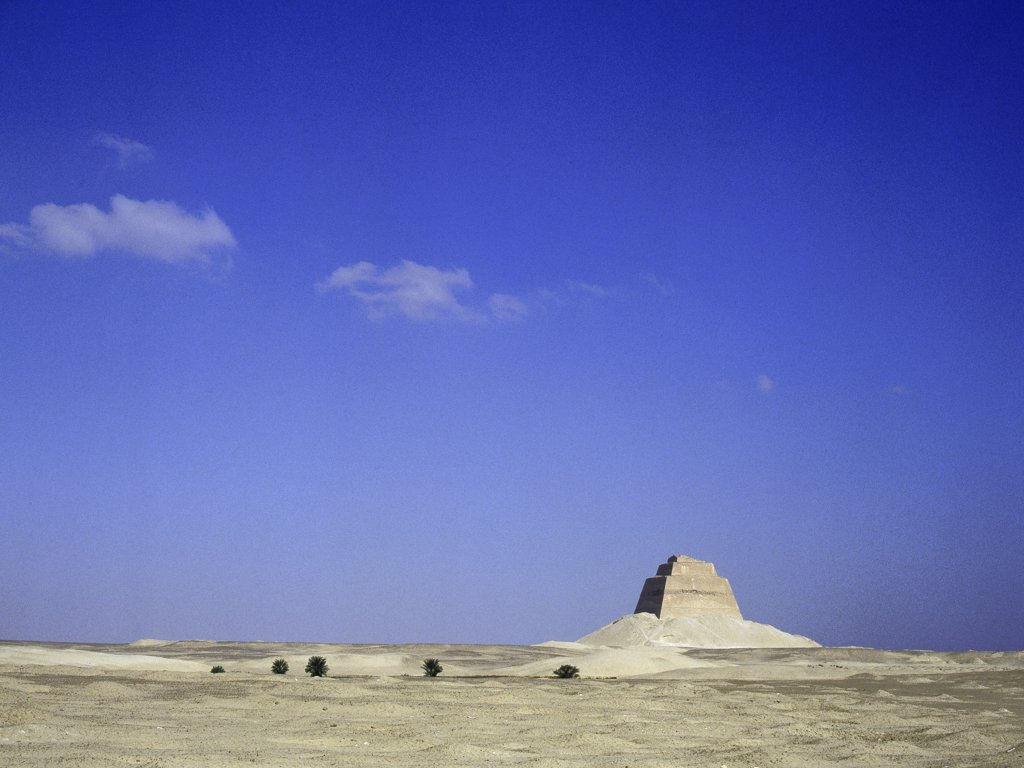 Stock Photo: 1899-64334 The inner core of the pyramid of Meidum, surrounded by the debris of its collapsed outer covering,The pyramid at Meidum represents the transitional stage of development from step pyramid enclosures to the full pyramid complexes. Egypt. Ancient Egyptian. Old Kingdom. Meidum