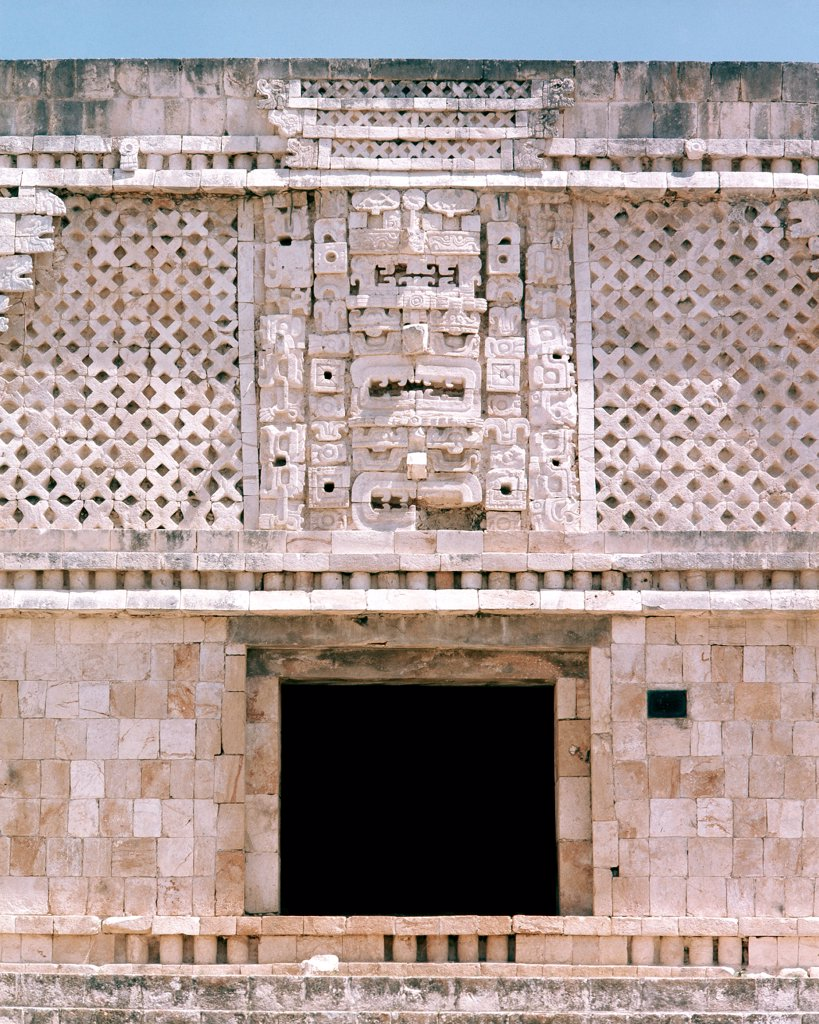 Facade of one of the buildings of the Nunnery quadrangle at Uxmal, Detail shows the mask of Chac, the Mayan god of rain. Mexico. Maya. Classic period 550-900 AD. Yucatan. : Stock Photo