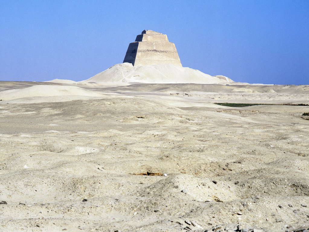 Stock Photo: 1899-64523 The inner core of the pyramid of Meidum, surrounded by the debris of its collapsed outer covering,The pyramid at Meidum represents the transitional stage of development from step pyramid enclosures to the full pyramid complexes. Egypt. Ancient Egyptian. Old Kingdom. Meidum