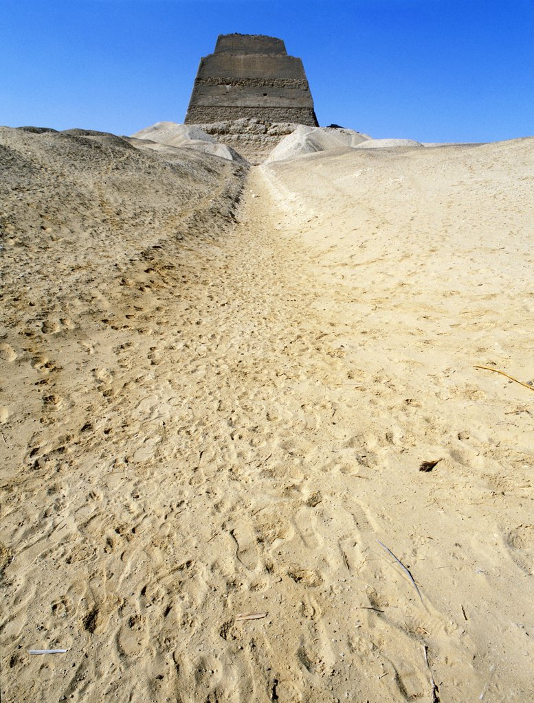 Stock Photo: 1899-64524 The inner core of the pyramid of Meidum, surrounded by the debris of its collapsed outer covering,The pyramid at Meidum represents the transitional stage of development from step pyramid enclosures to the full pyramid complexes. Egypt. Ancient Egyptian. Old Kingdom. Meidum
