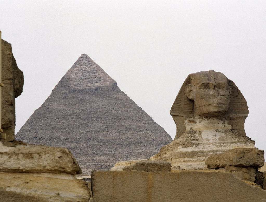 Stock Photo: 1899-64533 The Giza Sphinx with the pyramid of Khephren in the background, Egypt. Ancient Egyptian. Old Kingdom 4th dynasty. Giza.