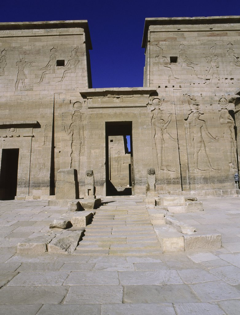 Stock Photo: 1899-64556 First pylon with an entrance into the temple of Isis which was recently transferred from the island of Philae to the island of Agilkia, Egypt. Ancient Egyptian. Ptolemaic period 323 BC-30 AD. Philae, now island of Agilkia.