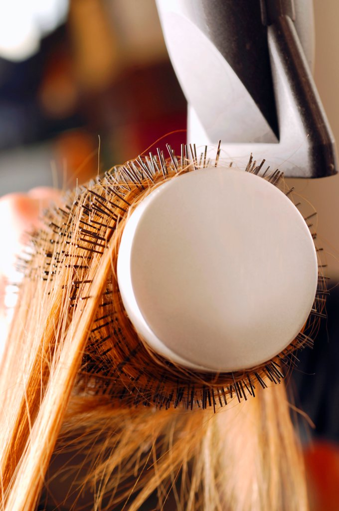 Close up of hair being brushed and dried with hair dryer : Stock Photo
