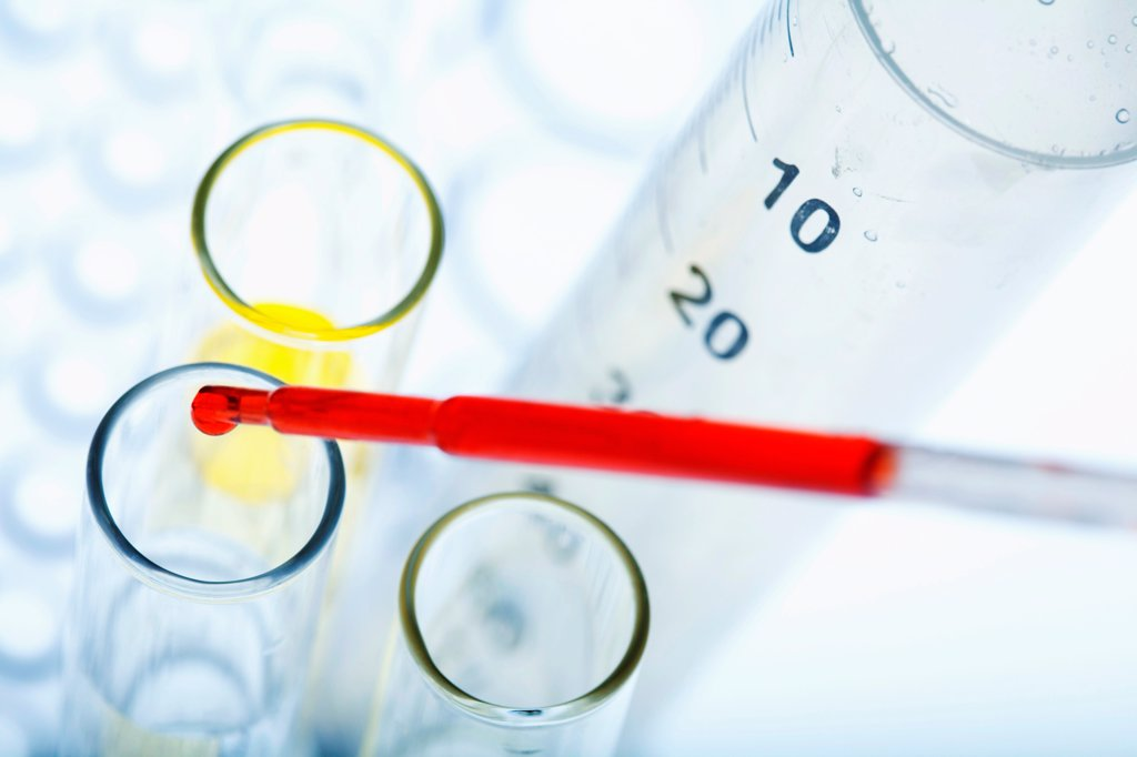 Stock Photo: 1899-66506 Pipetting red liquid into test tubes