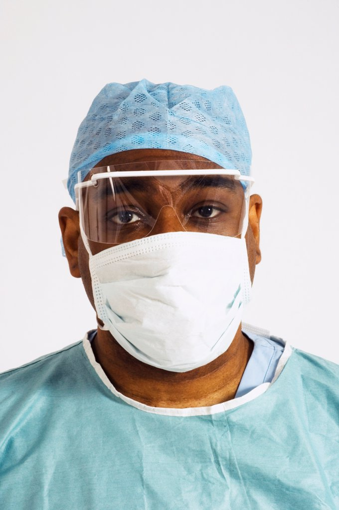 Stock Photo: 1899-66559 Portrait of surgeon wearing hygiene hat,