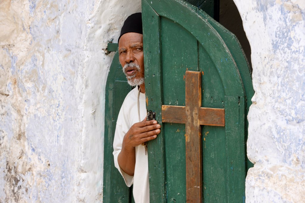 Egyptian coptic priest at the Holy Sepulcher, Jerusalem : Stock Photo