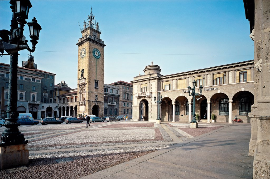 Italy, Lombardy, Bergamo. Detail. View of the portico and the clocktower. : Stock Photo