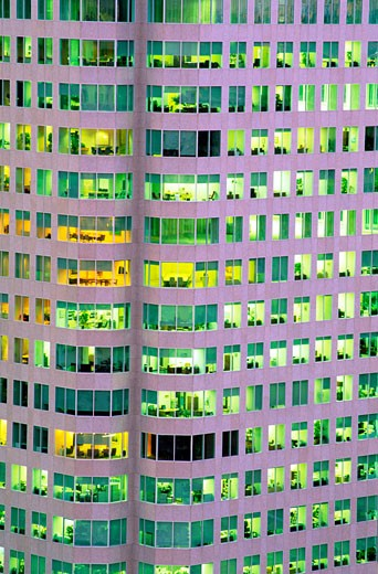 Canada Ontario Toronto close-up of office tower with rooms illuminated : Stock Photo