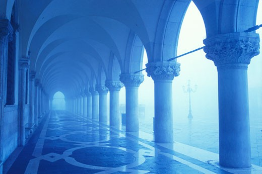 Stock Photo: 1902-1446 Italy Venice The Doges Palace columns and arches in the fog with blue tones