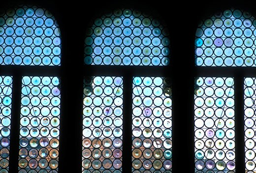 Italy Venice The Doges Palace Palazzo Ducale detail of windows with stained Venetian glass : Stock Photo