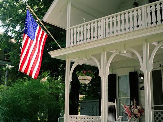 Stock Photo: 1902-1676 USA New York Chautauqua Victorian home displaying the American flag