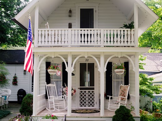 USA New York Chautauqua Victorian home displaying the American flag : Stock Photo