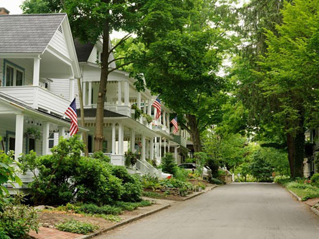 USA New York Chautauqua Street scene with homes displaying US flags : Stock Photo