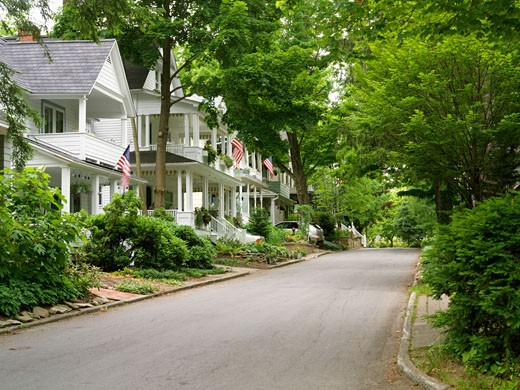 USA New York Chautauqua Street scene with homes displaying US flags : Stock Photo