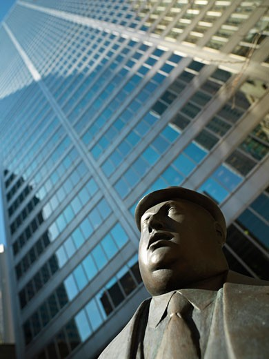 Canada Ontario Toronto bronze sculpture by William McElcheran Encounter low angle view of business man and skyscraper : Stock Photo