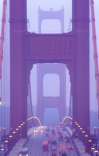 USA California San Francisco Golden Gate Bridge illuminated at dusk with traffic streaks : Stock Photo