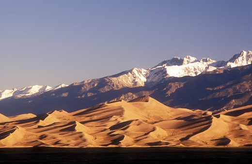 Stock Photo: 1902-2091 USA Colorado Great Sand Dunes National Park sand dunes with  Sangre de Cristo Mountains in the background