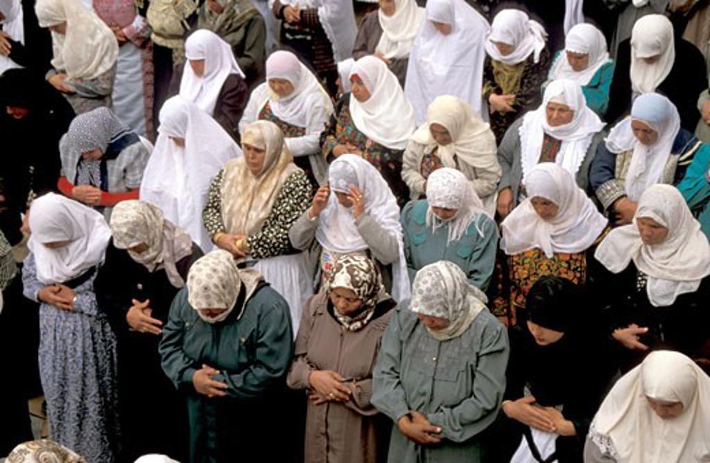 The Judean desert women praying at Nabi Musa : Stock Photo
