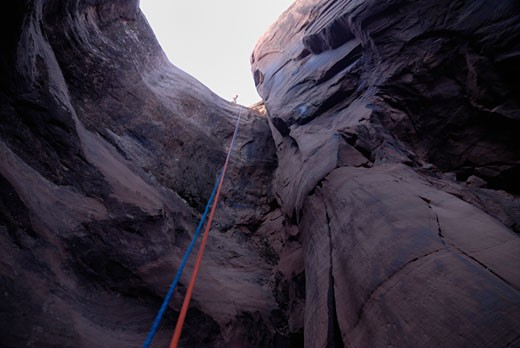 Rope hanging down a cave on the slick rock trail near Arches Bows national Park Utah USA : Stock Photo
