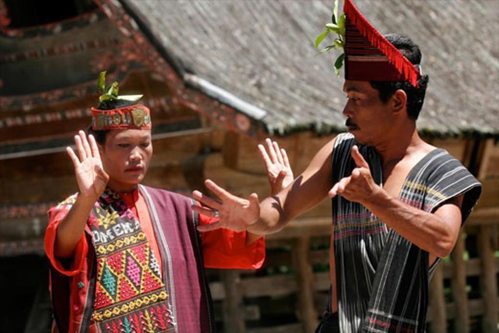 Woman and man dancing at a batak dance show in Samosir Lake Toba Sumatra Indonesia : Stock Photo