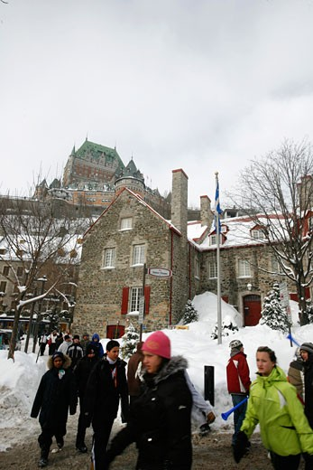 Some pupils on the Cours Champlain in the backyard the Chateau Frontenac Quebec City Quebec : Stock Photo