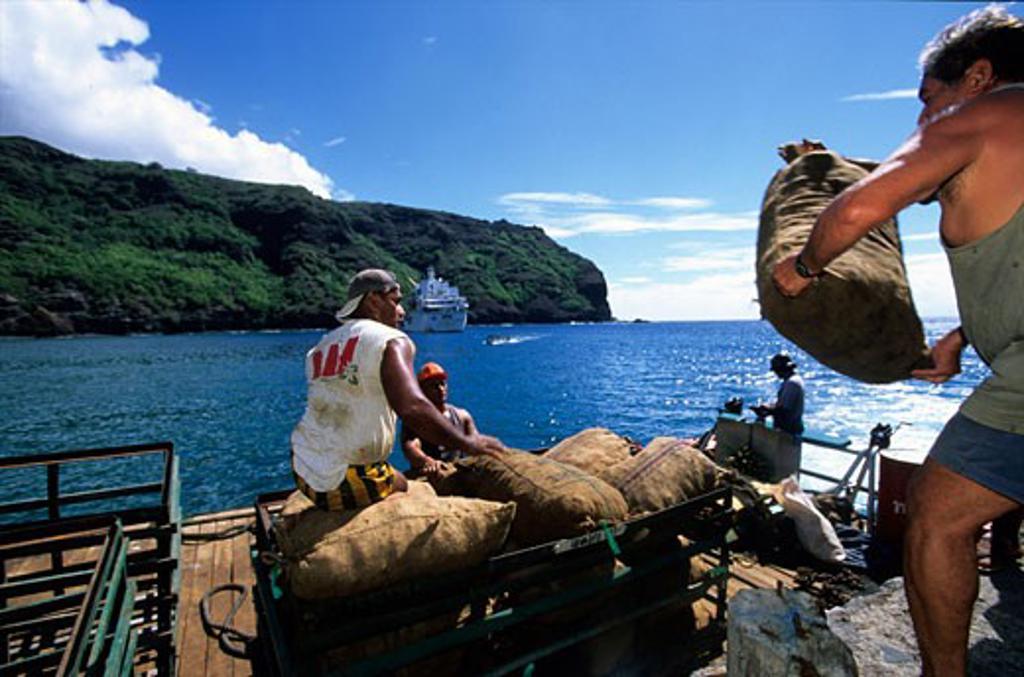 Stock Photo: 1907-2934 Disembarking goods from the Aranui at Puamau bay Nuku Hiva island Marquises islands