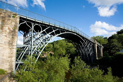 The worlds first iron bridge spans the banks of the River Severn in late evening summer light Ironbridge Shropshire England United Kingdom GB Great Britain British Isles Europe EU : Stock Photo