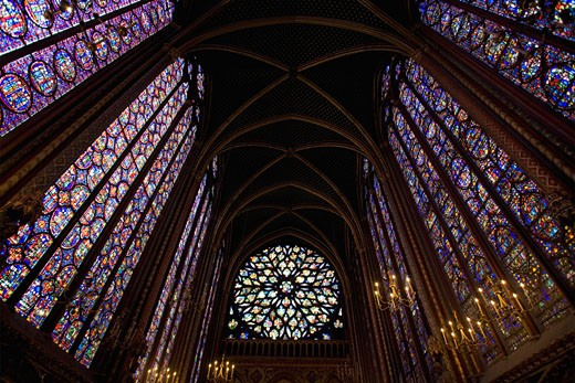 Interior of Sainte-Chapelle showing medieval stained glass window panels Paris France Europe EU : Stock Photo