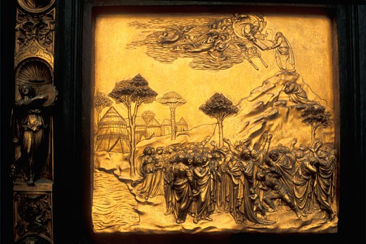 Florence Duomo Baptistry East doors Lorenz Ghiberti Florence Tuscany Italy Italia Europe Lorenzo Ghiberti worked on the east doors from 1424 1452 Michelangelo called them the Gates of Paradise This panel shows Moses receiving the Ten Commandments : Stock Photo