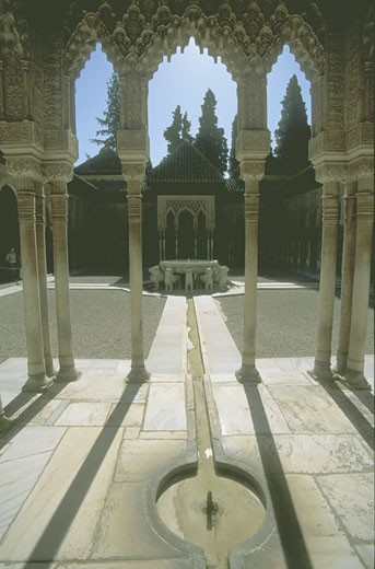 Stock Photo: 1909-1933 Chamber of the Lions Alhambra Granada Andalucia Spain Espana Europe Day time shot of the Patio of the Lions in the heart of the harem section of the Moorish palace and fortress at the Alhambra Granada Andalucia Spain Espana Europe
