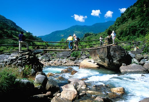 Stock Photo: 1909-2220 The Siklis Trail south of Annapurna is off the beaten track Here the trek crosses the Seti river by bamboo bridge Annapurna region Nepal Asia