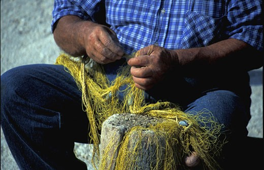 Stock Photo: 1909-2392 Greek Islands fisherman mending nets Cephalonia Kefalonia Ionian sea Greece Europe