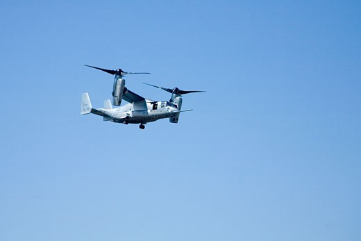Stock Photo: 1909-3170 Bell Boeing V-22 V 22 V22 Osprey tiltrotor aircraft flying in blue skies at the RAF International Air Show in Fairford Gloucestershire in 2006The aircraft takes off and lands like a helicopter but once airborne converts to a turboprop airplane