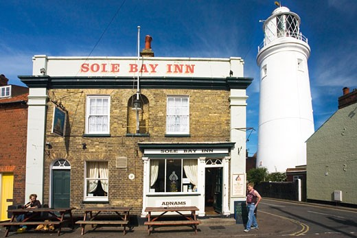 Stock Photo: 1909-3238 Sole Bay Inn and lighthouse Southwold Suffolk  East Anglia England UK United Kingdom GB Great Britain British Isles Europe EU