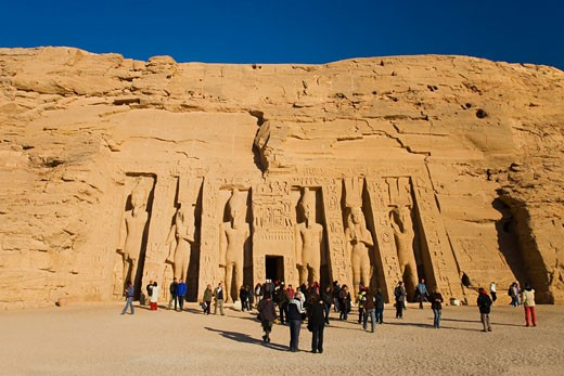 Stock Photo: 1909-3294 Abu Simbel Small Temple exterior entrance statue carvings showing Ramses II and Queen Nefertari Nubia Upper Egypt North Africa