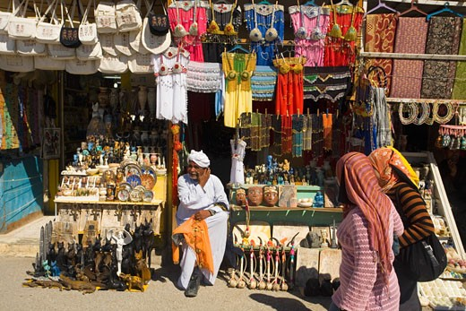 Egyptian market stall selling tourist souvenirs gifts Luxor Egypt North Africa : Stock Photo