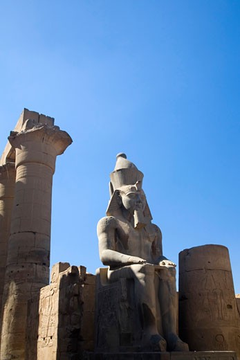 Stock Photo: 1909-3367 Statue of Ramses II in summer sun sunshine Karnak Temple Luxor Egypt Africa Karnak Temple is the largest temple complex ever built and was gradually enlarged by successive pharoahs over a thirteen hundred year period
