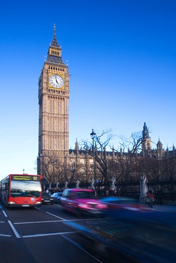Stock Photo: 1909-3639 Big Ben clock clocktower red bus and taxi Parliament Square in evening sun sunshine in spring winter London England GB Great Britain UK United Kingdom British Isles Europe EU