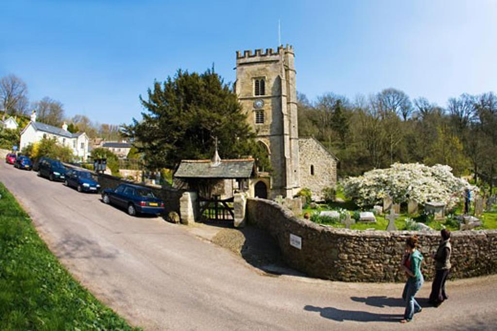 Stock Photo: 1909-3743 English village parish church and graveyard Salcombe Regis Devon in spring with cherry blossom England UK United Kingdom GB Great Britain British Isles