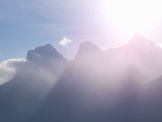 Three Sisters Mountain with ice haze during cold weather  above Canmore  Canada  Alberta : Stock Photo