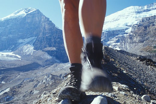 Stock Photo: 1910-1289 Hiker on crest of moraine below Mt Lefroy Mt Victoria and Death Trap near Lake Louise in Banff Natl Park CANADA Alberta