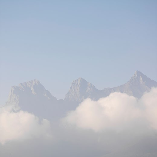 Three Sisters Mountain with morning clouds rising above Canmore CANADA Alberta : Stock Photo