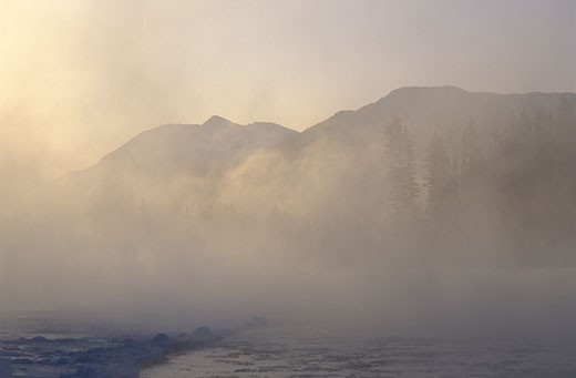 Steam rising from Bow River on very cold morning -40 degrees Canmore CANADA Alberta : Stock Photo