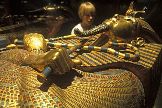 Boy 8 yrs looking at tomb of Tutankhamun at th Egyptian Museum Cairo Today Tutankhamun is the most famous Egyptian pharaoh The boy king died in his late teens and remained at rest for over 3300years EGYPT Cairo : Stock Photo
