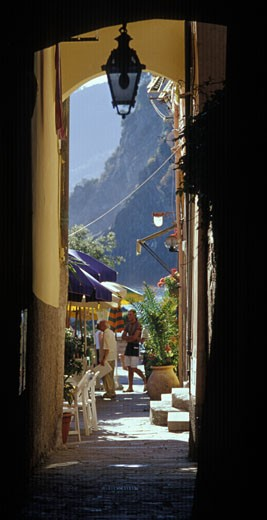 Stock Photo: 1910-1606 Archway detail of one of 5 famous towns of the Cinque Terre Vernazza It has no car traffic a road leads into a parking lot on the edge of the town and remains one of the truest fishing villages on the Italian Riviera ITALY Liguria
