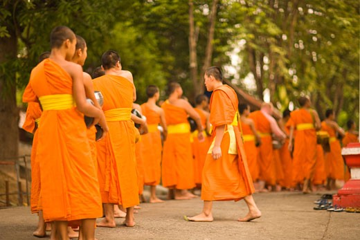 Stock Photo: 1911-1047 Buddhist Monks collecting food and special Sonkran Blessing  Wat Srisoda  Buddist Temple and Monastery  Chiang Mai  Thailand  SE Asia