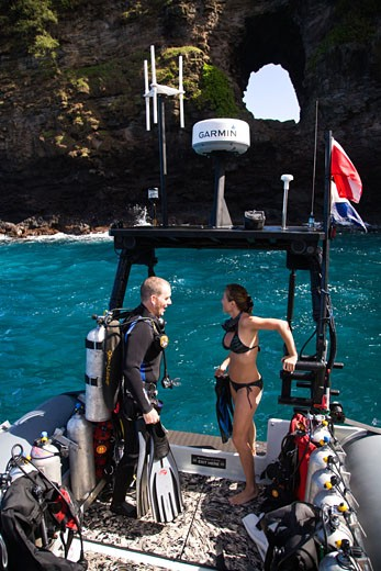 Stock Photo: 1911-1385 Hole in the Wall   North Shore Explorers  frontier scuba diving on the rugged North Maui Shore  Maui  Hawaii  USA